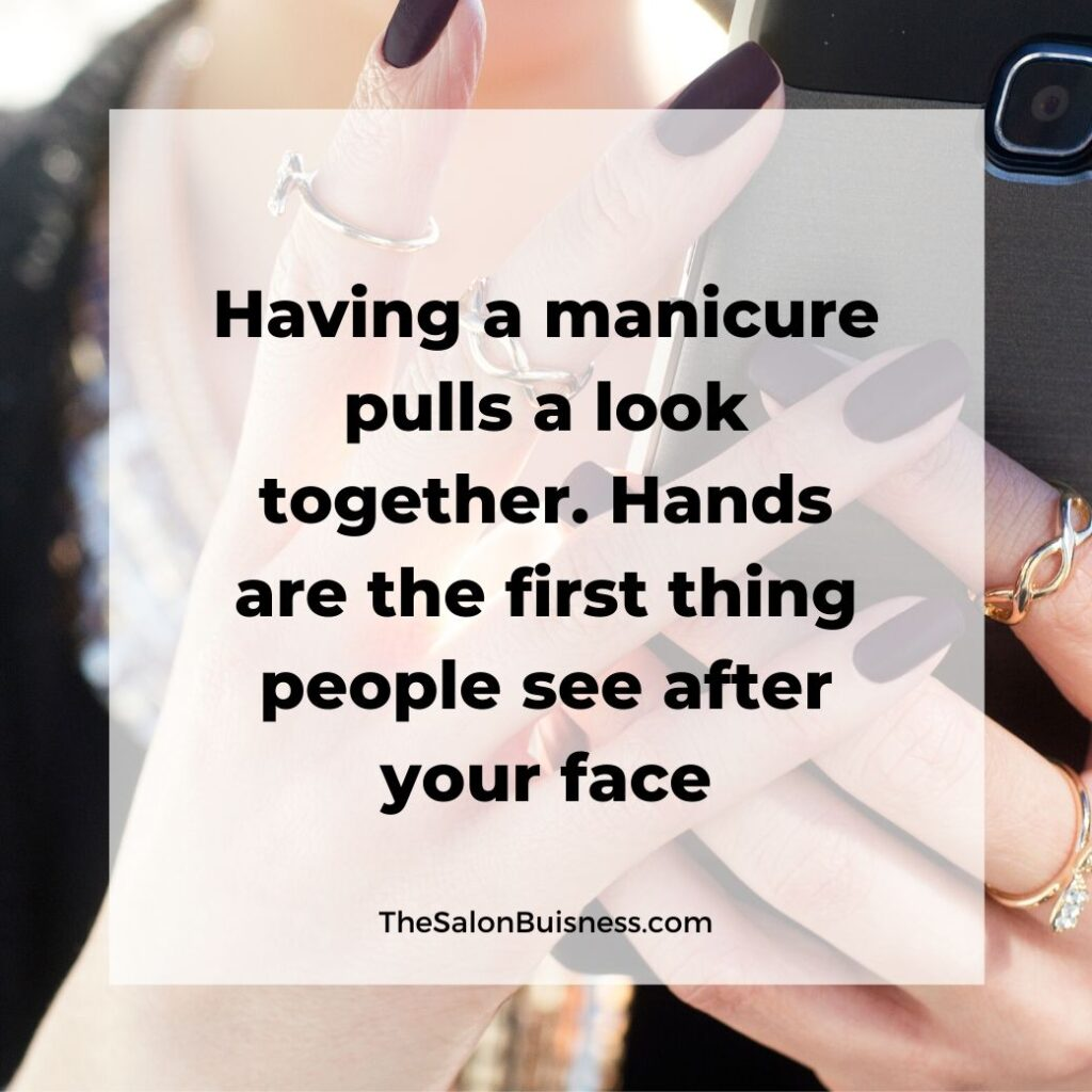 Inspiring manicure quotes - woman with fake nails holding phone.jpg
