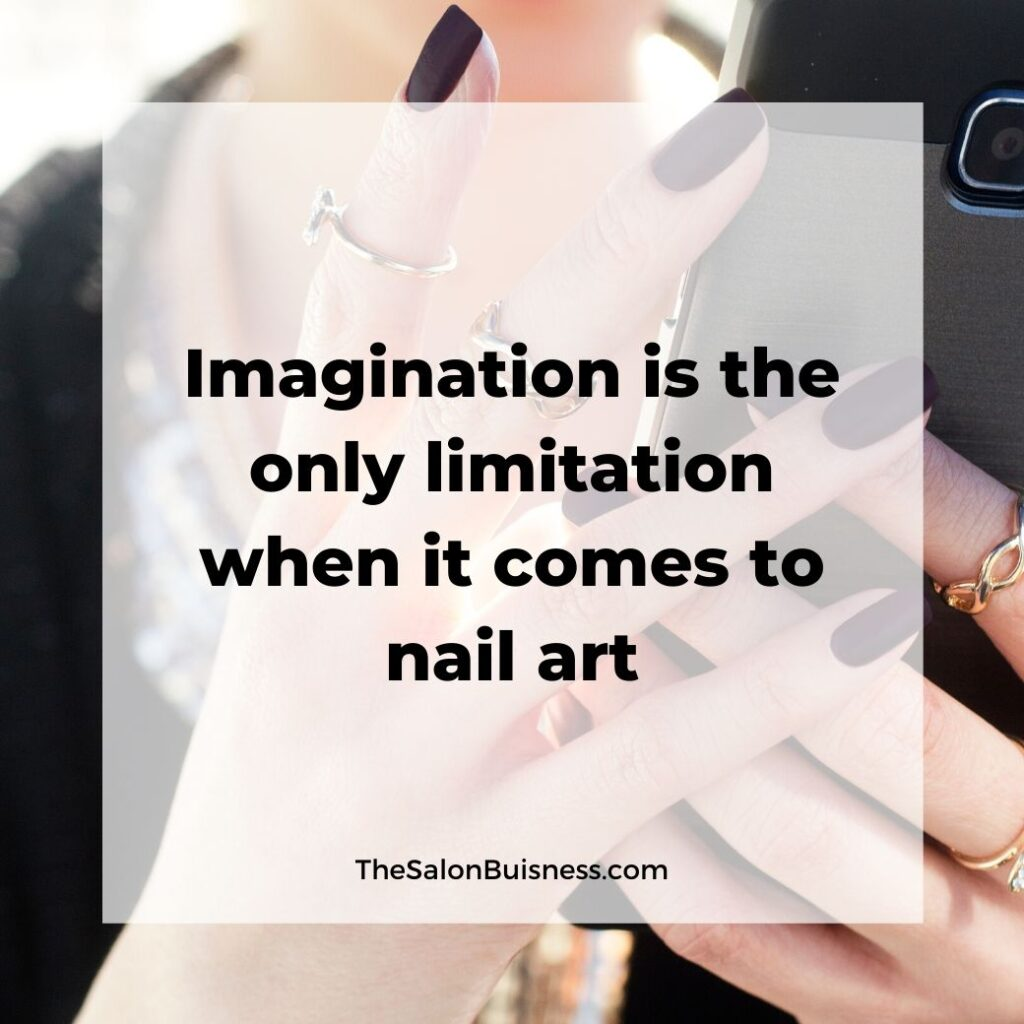 Nail art imagination quote - woman holding phone with dark nails
