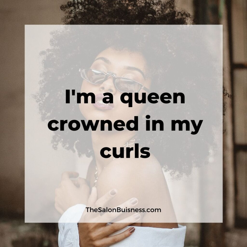inspiring hair care quotes  - woman with black curly afro in white shirt and sunglasses