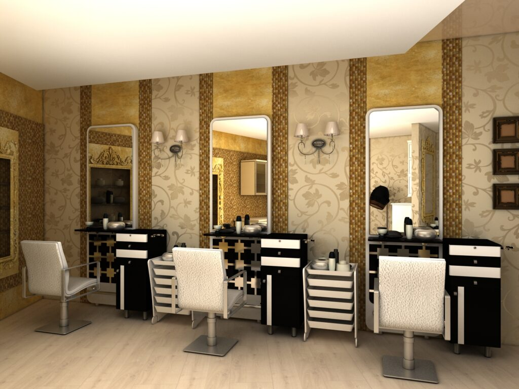gold textured walls with vintage style wallpaper. Black & white color theme with the chairs & tables & a chandelier hanging. routine style shop.